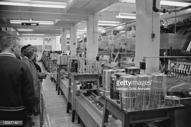 Tourists on a tour of the chocolate factory in Hershey Derry Township Pennsylvania USA November 1969