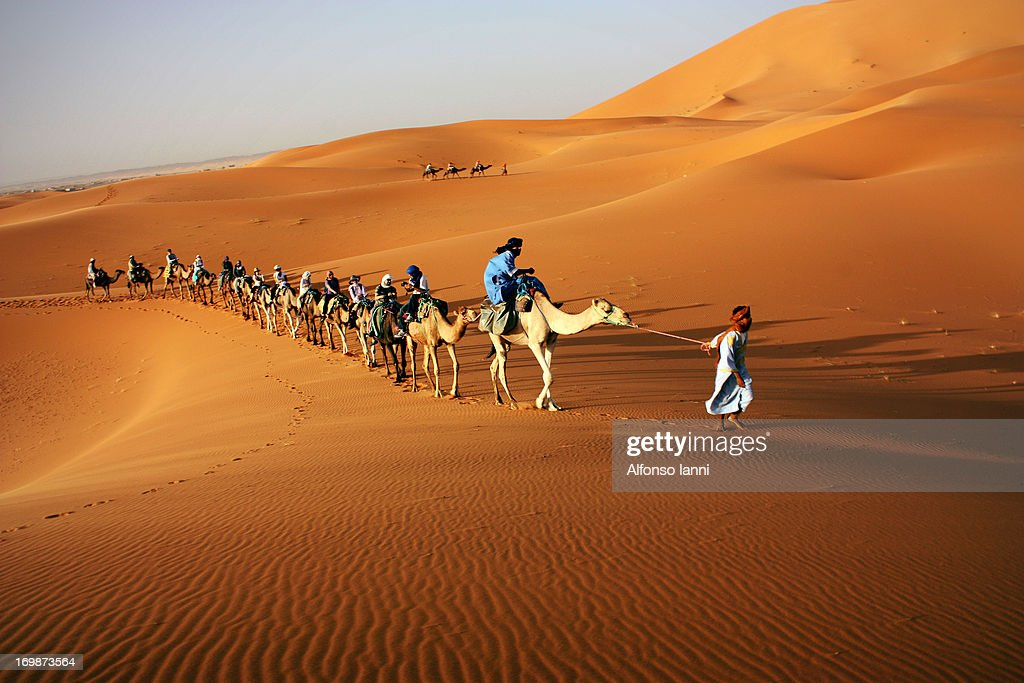 CONTENT] Tourists on a Trip in the Sahara Desert riding Camels.