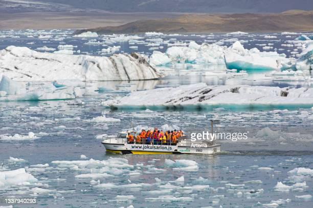 Tourists on amphibian boat tour at Jškuls‡rl—n. Joekusarlon in summer, glacial lake in southern part of Vatnajškull National Park, southeast Iceland.