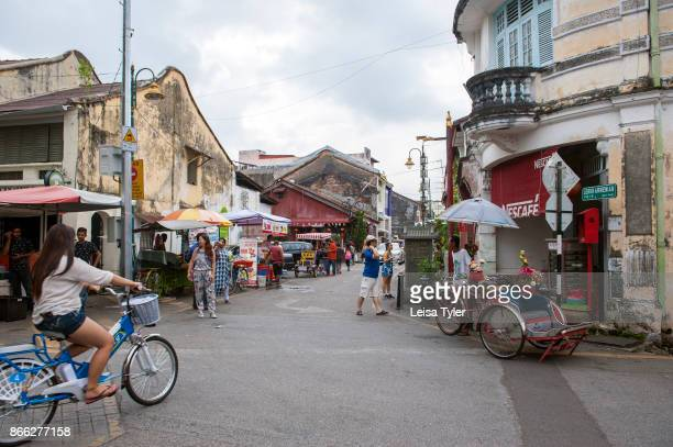 Tourists on Armenian Street in George Town Penang In the heart of the World Heritage district the street is well known for its old clan temples and...