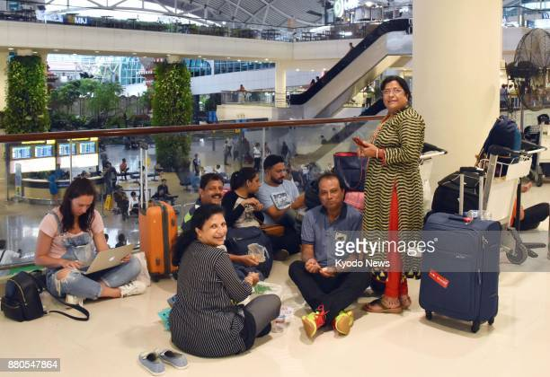Tourists on Bali Island are stranded at an airport in Denpasar on Nov 27 2017 as their return flights were canceled following a volcanic eruption on...