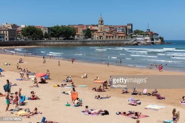 Tourists on beach on San Lorenzo beach, Gijon, Asturias, Spain, on July 14, 2020 with limited capacity due to the coronavirus.
