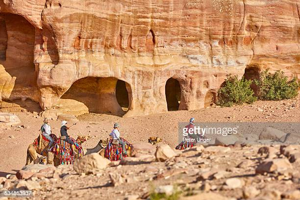 Tourists on Camel rides in Petra