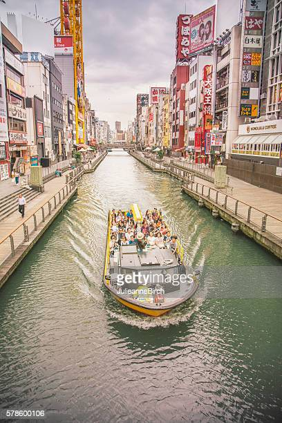 Tourists on canal, Dotonburi, Osaka, Japan