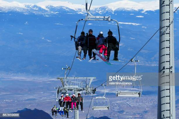 tourists on chairlift in bansko, bulgaria - bansko stock pictures, royalty-free photos & images