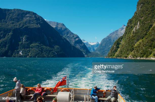 Tourists on cruise boat in Milford Sound.