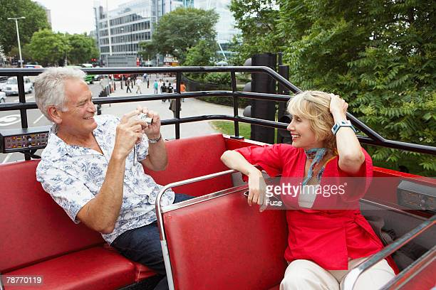 tourists on double-decker bus - double decker bus stock pictures, royalty-free photos & images