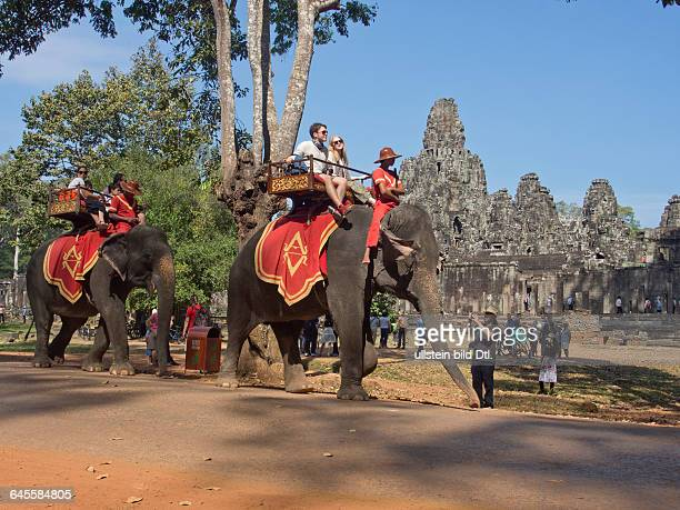 Tourists on elephants at the Angkor Wat archaelogical park, Cambodia