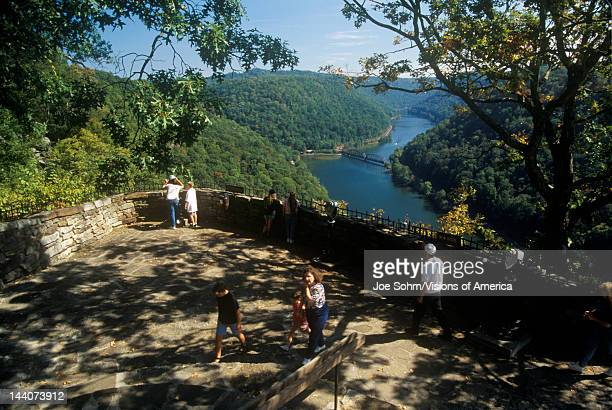 Tourists on Hawks Point State Park Overlook on Scenic Highway US Route 60 over the New River in Ansted WV