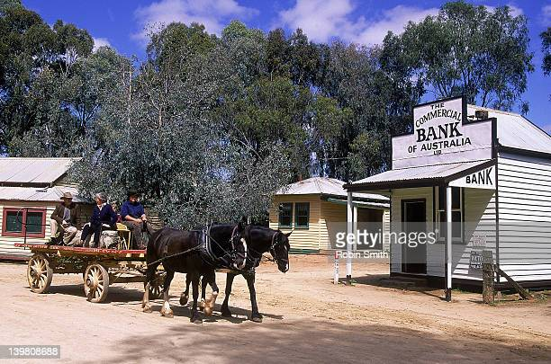 Tourists on horse-drawn cart at Swan Hill Pioneer Settlement, Victoria