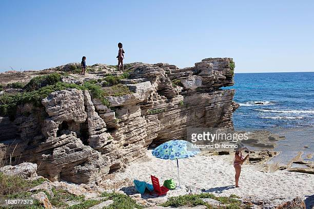 Tourists on Is Arutas beach on July 09 2013 in Province of Oristano Italy