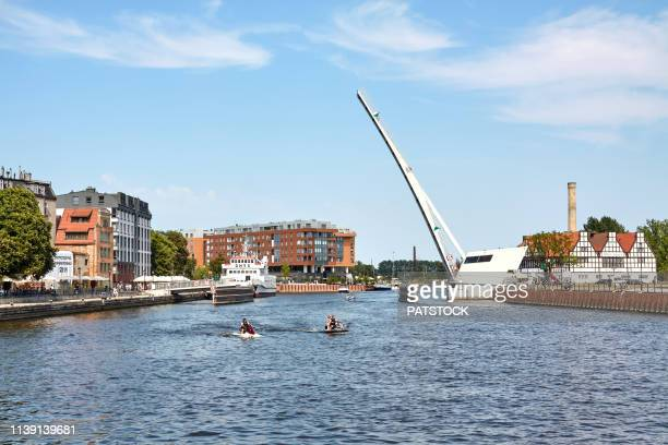 tourists on jet boats on motlawa river in gdansk - motlawa river stock pictures, royalty-free photos & images