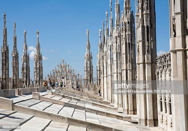 Tourists on Milan Cathedral rooftop, Milan, Lombardy, Italy