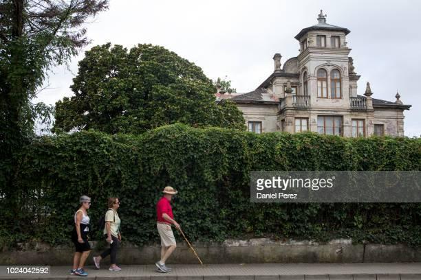 Tourists on Palacio de Partarriu also know as Villa Parres on July 29, 2018 in Llanes, Spain.