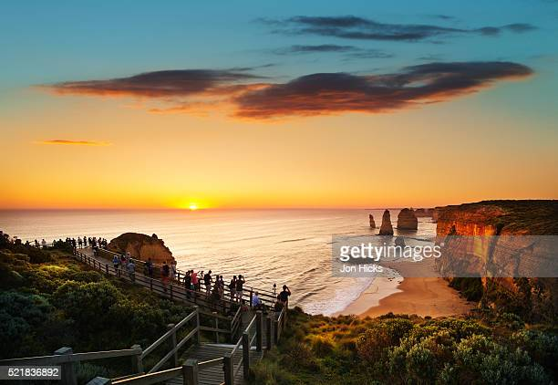 Tourists on platforms looking at The Twelve Apostles