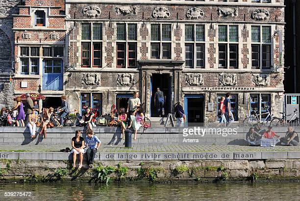 Tourists on quay along the river Lys with view over the Graslei / Grass Lane at Ghent Belgium