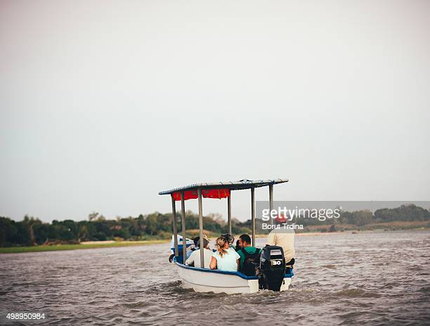tourists on rufiji river - wildlife reserve stock pictures, royalty-free photos & images