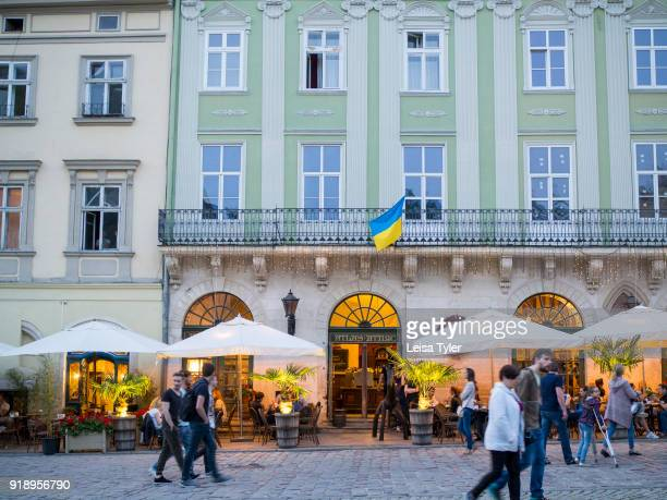 Tourists on Rynok or Market Square the main square in the old town of Lviv in Ukraine Its well preserved architecture which blends Central and...
