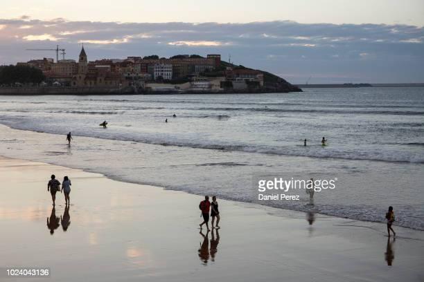 Tourists on San Lorenzo beach on July 29 2018 in Gijon Spain