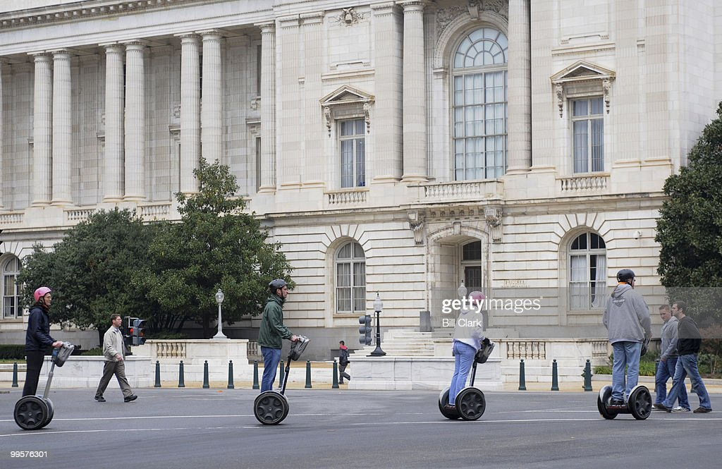 Tourists on Segways cross 1st Street NE at Constitution Ave. NE by the Russell Senate Office Building on Monday, Nov. 12, 2007.