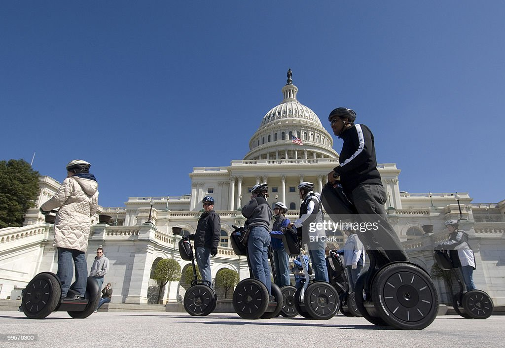 Tourists on Segways cruise past the West Front of the U.S. Capitol building on Thursday, March 20, 2008, a chilly and windy first day of Spring.