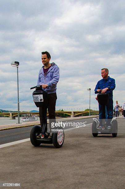 tourists on segways - segway stock pictures, royalty-free photos & images
