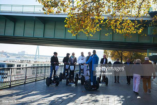Tourists on segways with guide
