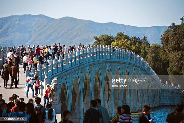 Tourists on seventeen arch bridge over Kunming lake, elevated view