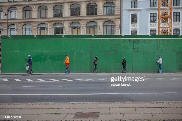tourists on sightseeing in copenhagen - segway stock pictures, royalty-free photos & images