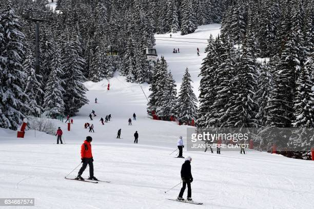 Tourists on ski ride down a slope in the French Alps ski resort of Courchevel on February 10 2017 Courchevel is a magnet for the international...