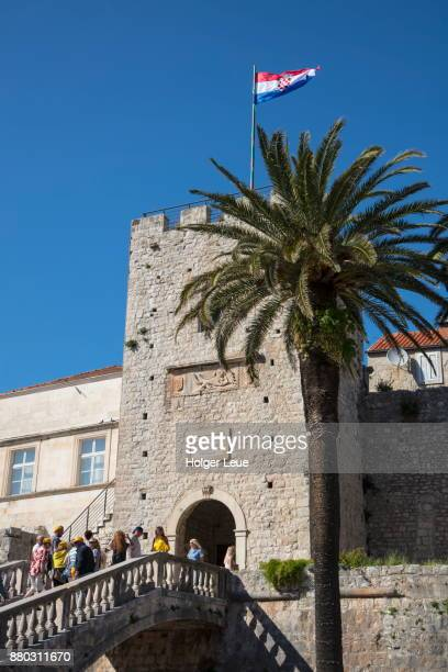 Tourists on stairs leading to Old Town with Tower Revelin, Korcula, Dubrovnik-Neretva, Croatia