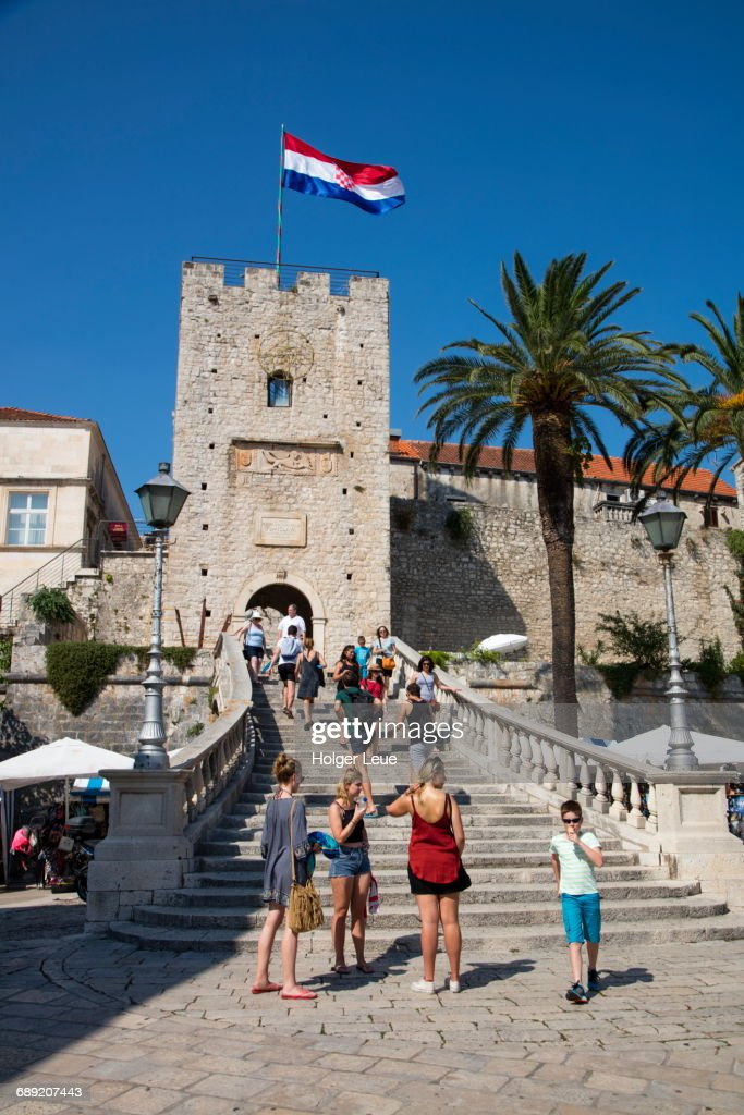 Tourists on stairs to Old Town with Tower Revelin : Stock Photo