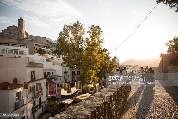 Tourists on street of Old Town Ibiza, Spain