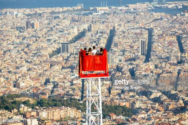 Tourists on the amusement ride in Tibidabo mountain park, Barcelona, Catalonia, Spain