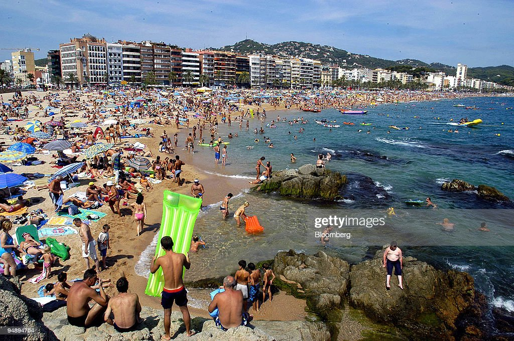 Tourists On The Beach At Lloret De Mar Girona Spain Sunday August