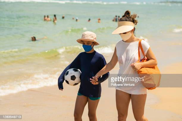 tourists on the beach during the coronavirus pandemic - uv protection stock pictures, royalty-free photos & images