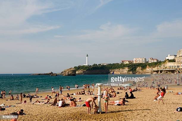 Tourists on the beach, Grande Plage, Phare de Biarritz, Biarritz, France