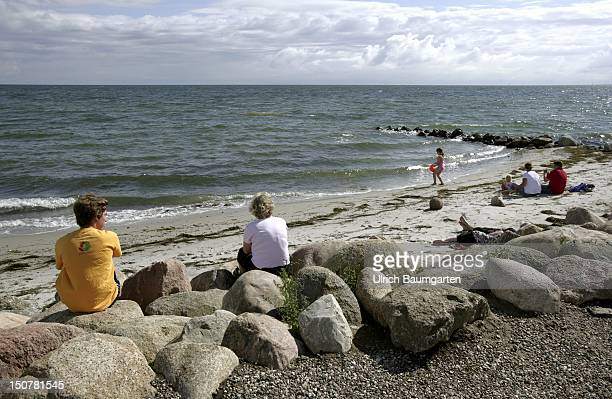 GERMANY FEHMARN Tourists on the beach of the Baltic Sea
