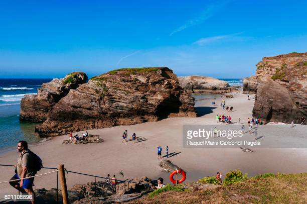 CATHEDRALS RIBADEO ASTURIAS SPAIN Tourists on the beach of the Cathedrals in summer