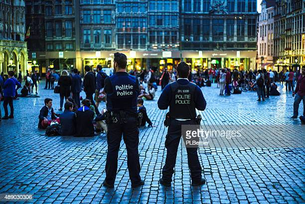 tourists on the grand place in brussels. - police force stock pictures, royalty-free photos & images