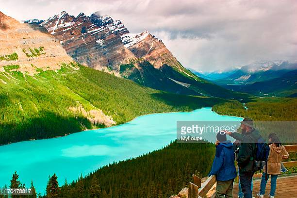 Tourists on the observation deck overlooking Peyto Lake on the Ice fields Parkway in Banff National Park