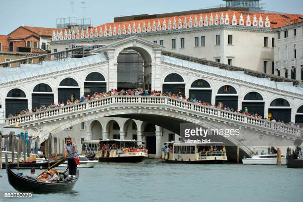 Venice Veneto Italy September 6 2016 Tourists on the Rialto Bridge overlooking the Grand Canal of Venice in Italy Caution For the Not for advertising...