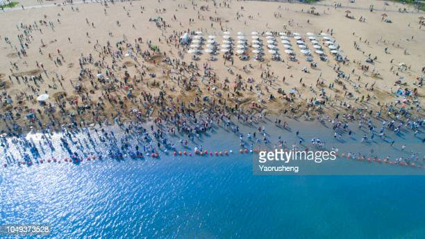 tourists on the sand beach of ningbo beilun,zhejiang province,china - ningbo stock pictures, royalty-free photos & images