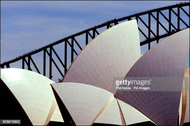 Tourists on the Sydney harbour bridge climb look like ants as they pass the sails of the Sydney Opera house