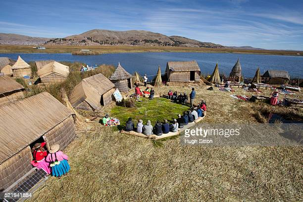 Tourists on the Uros islands of Titicaca. Puno, Peru.