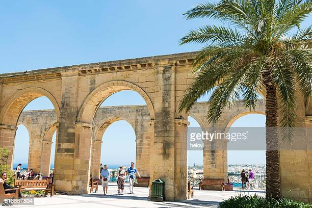Tourists on the wall of fortification of Valletta