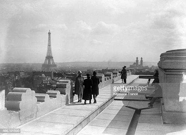 Tourists on top of the Arc de Triomphe, in July 1929 in Paris, France.