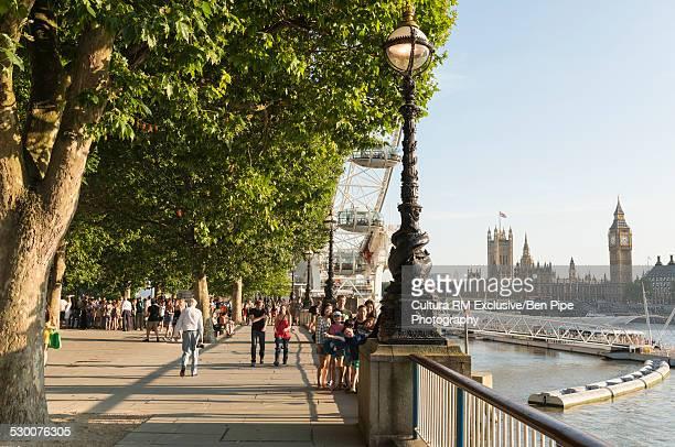 Tourists on Westminster Bridge, South Bank, London, UK