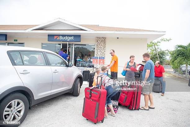 Tourists outside car rental office on Grand Cayman Island