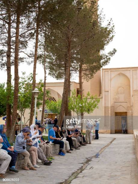 Tourists outside Nain Grand Mosque or 'Masjede Jame' Nain' in Persian a congregation mosque and one of Iran's oldest It originally dates to the 9th...